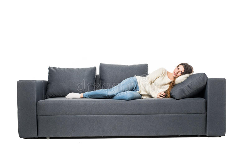 Portrait of beautiful young woman sleeping on couch stock image