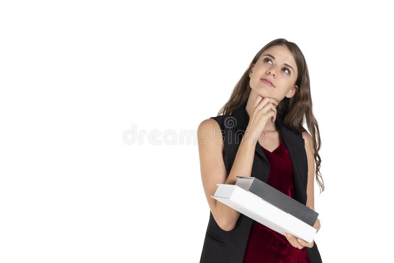 Portrait of beautiful young woman student, teacher or businesswoman holding books royalty free stock photo