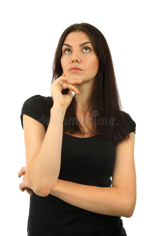 Portrait of a beautiful young woman thinking royalty free stock photography