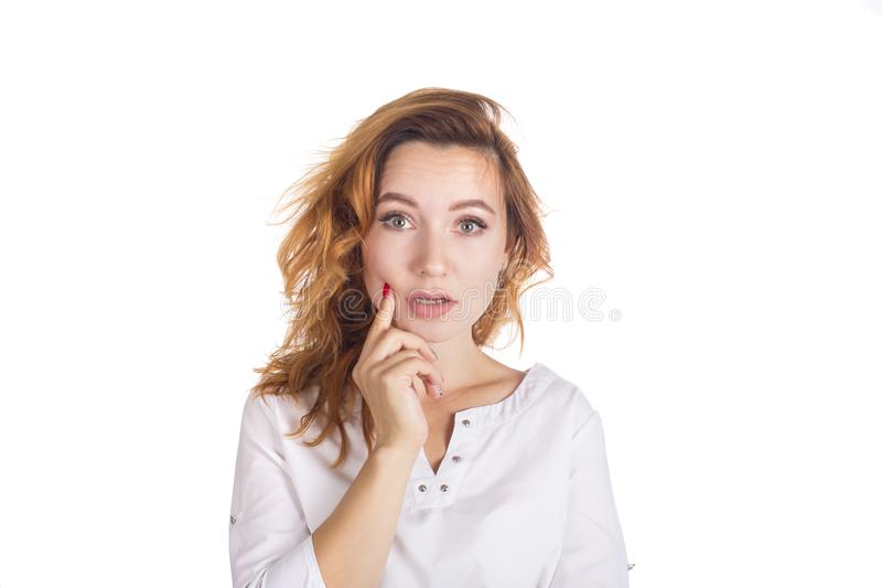 Portrait of a beautiful young woman thinking. she have an idea. royalty free stock image