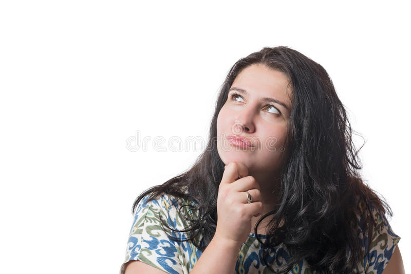 Portrait of a beautiful young woman thinking, isolated on white background royalty free stock photo