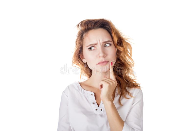 Portrait of a beautiful young woman thinking, isolated on white background stock images