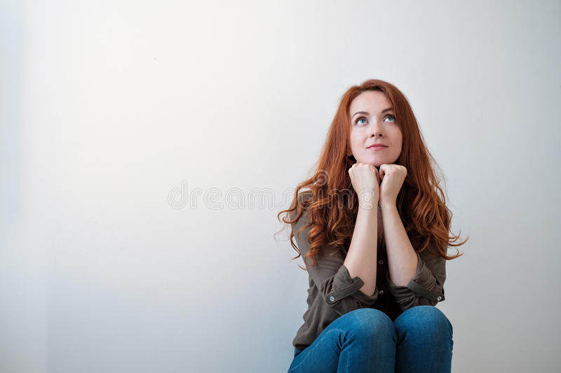 Portrait of a beautiful young woman thinking, on white background royalty free stock photo
