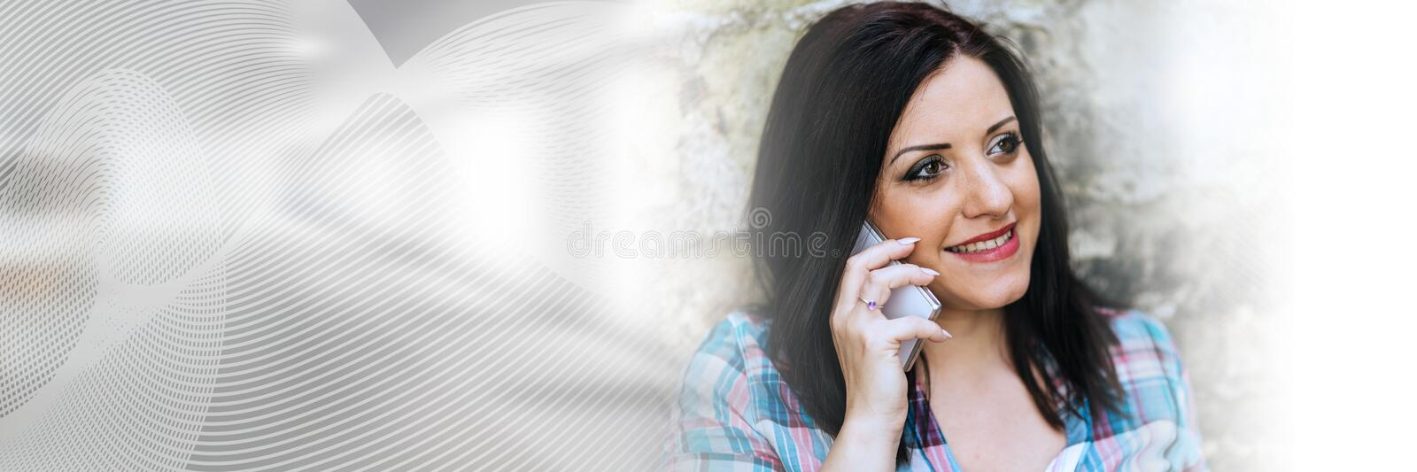Portrait of beautiful young woman using phone, light effect; panoramic banner stock photography