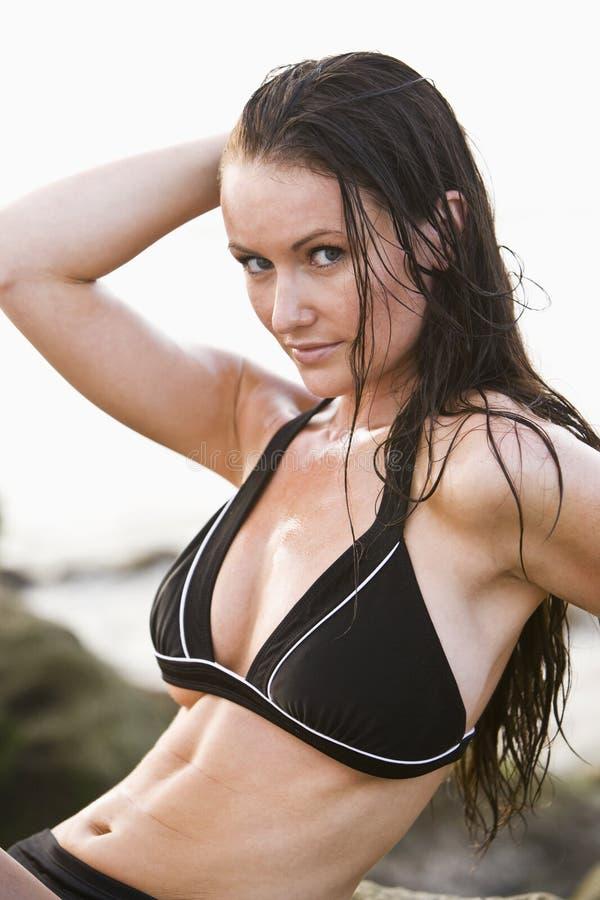 Portrait of beautiful young woman wearing bikini stock photo