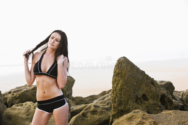 Portrait of beautiful young woman wearing bikini stock images