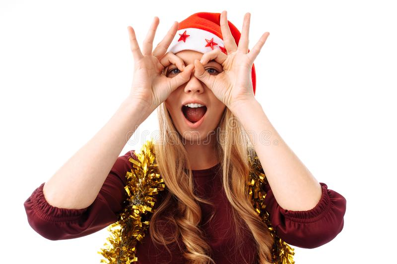 Portrait of a beautiful young woman wearing a santa hat, making royalty free stock image