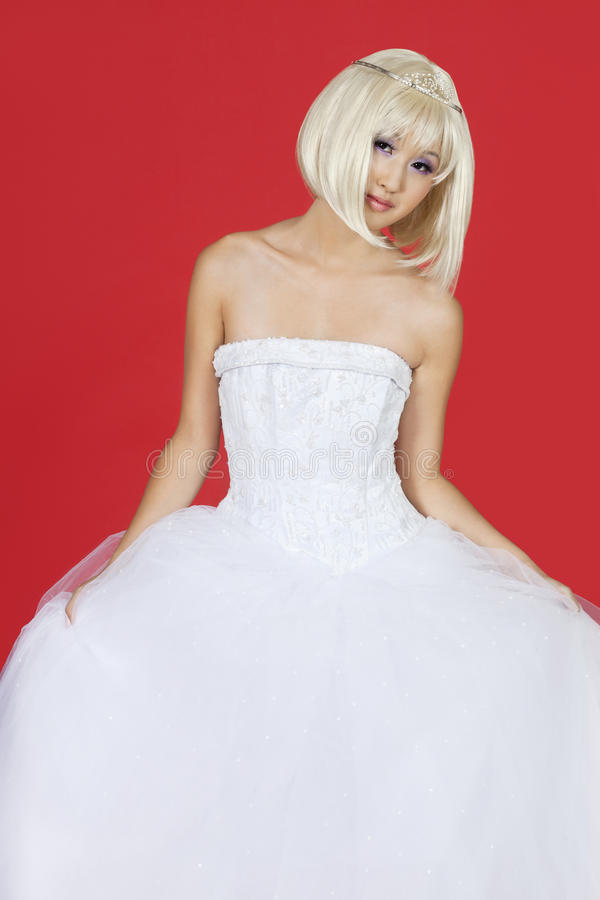 Download Portrait Of Beautiful Young Woman In Wedding Dress Standing Against Red Background Stock Image - Image: 30856499