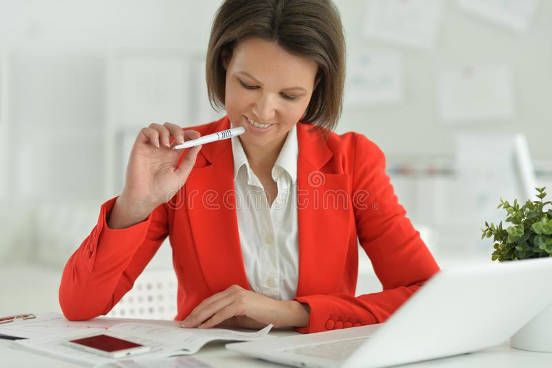 Portrait of a beautiful young woman working royalty free stock images