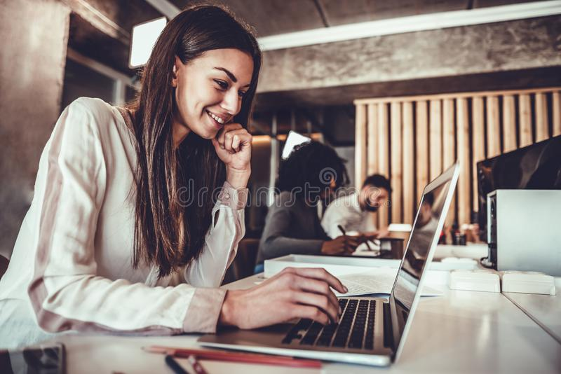 Portrait of beautiful young woman working in the office royalty free stock images