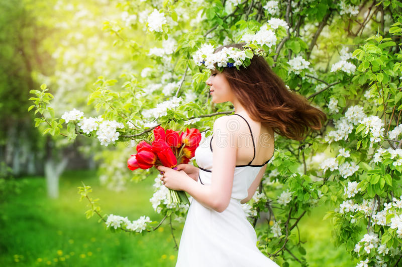 Portrait of a beautiful young woman in a wreath of spring flower royalty free stock photography