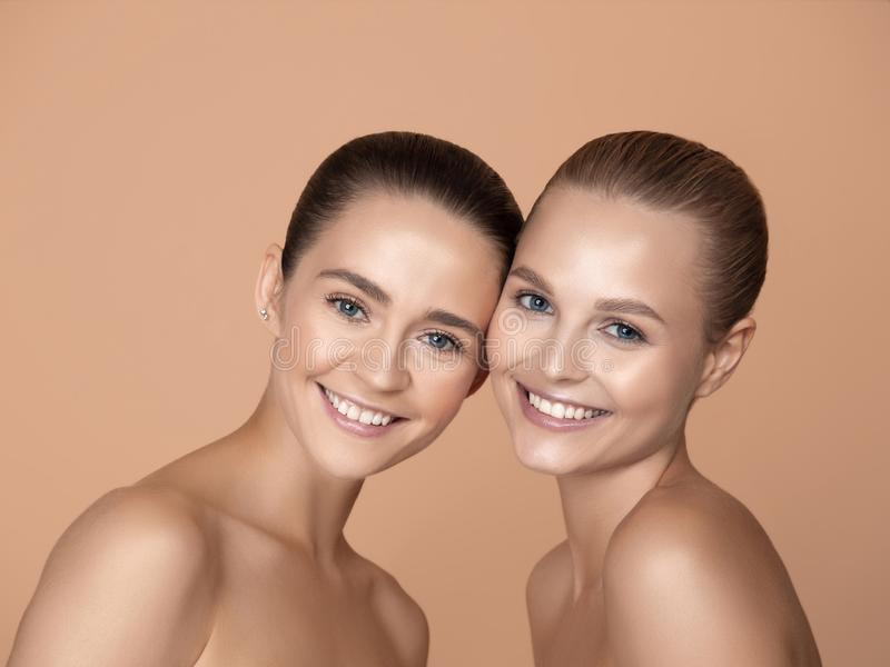 Portrait of beautiful young women isolated on brown studio background stock photos