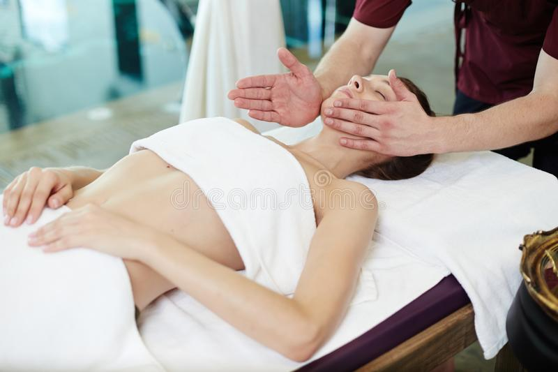 Male Masseur Massaging young Woman in SPA stock images