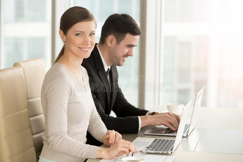 Businesswoman working with businessman in office royalty free stock photo