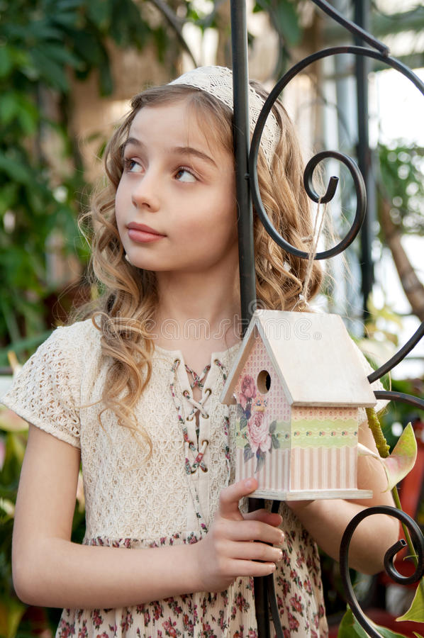 Portrait of beautifull girl with nesting box stock images