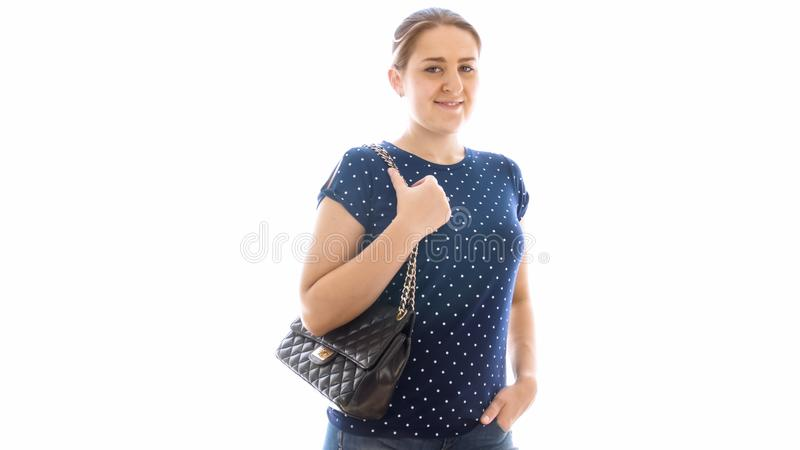 Portrait of beautitufl young woman with handbag over white backgorund royalty free stock images
