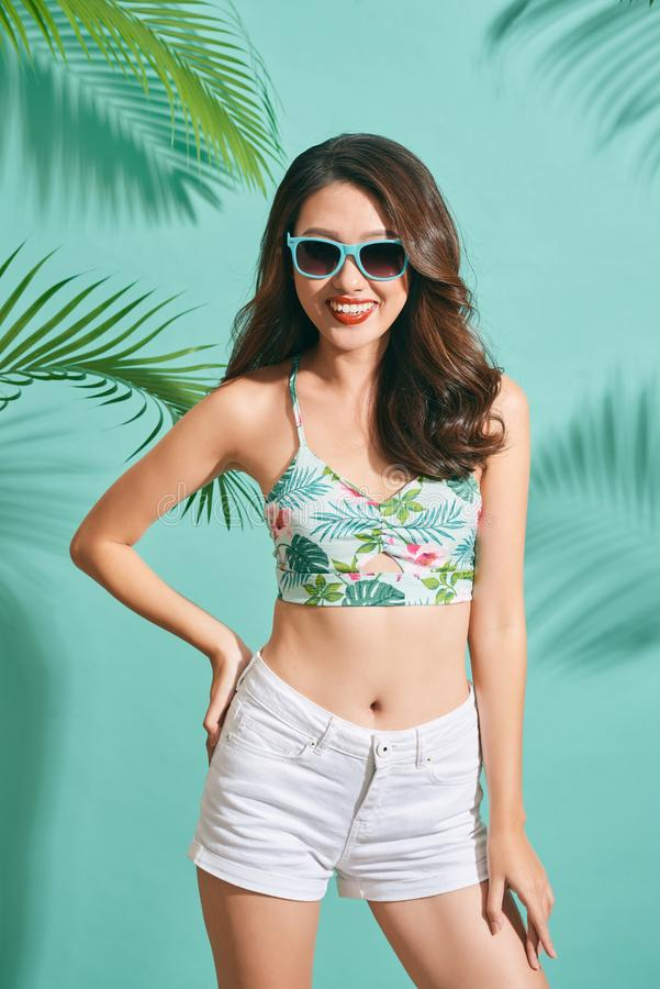 Portrait beauty asian model wearing glasses and crop top in summer time.  stock photography