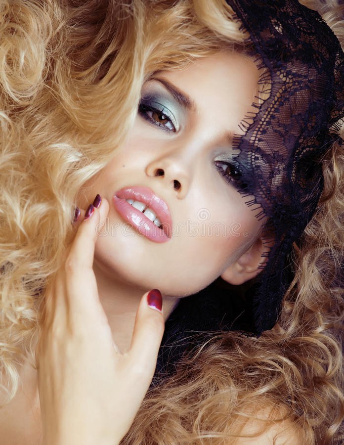 Portrait of beauty blond young woman through black lace close up sensual seduction stock image
