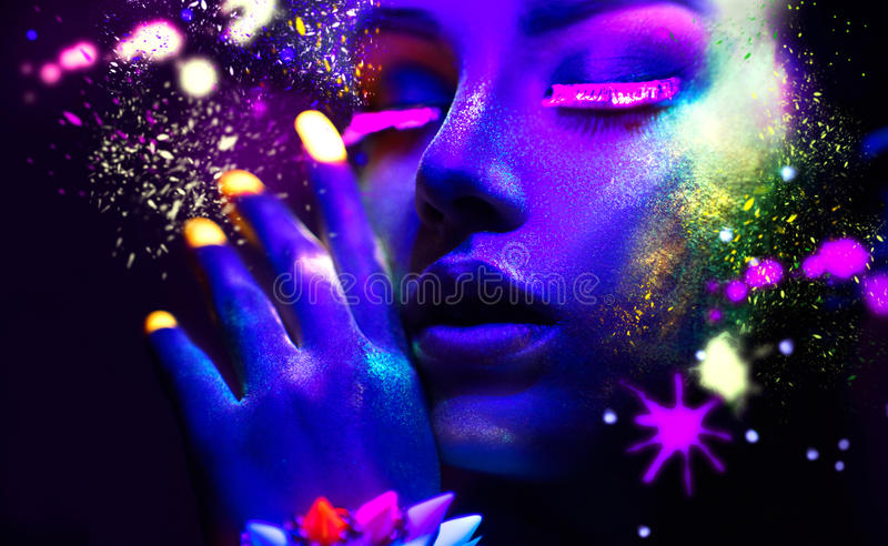 Portrait of beauty fashion woman in neon light royalty free stock images