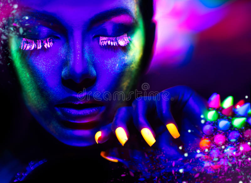 Portrait of beauty model with fluorescent makeup. Fashion woman in neon light, portrait of beauty model with fluorescent makeup stock photos