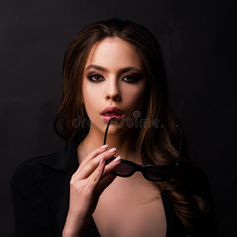 Portrait of beauty model girl with bright smokey make up. Young woman in sunglasses. Close-up portrait of a beautiful royalty free stock images