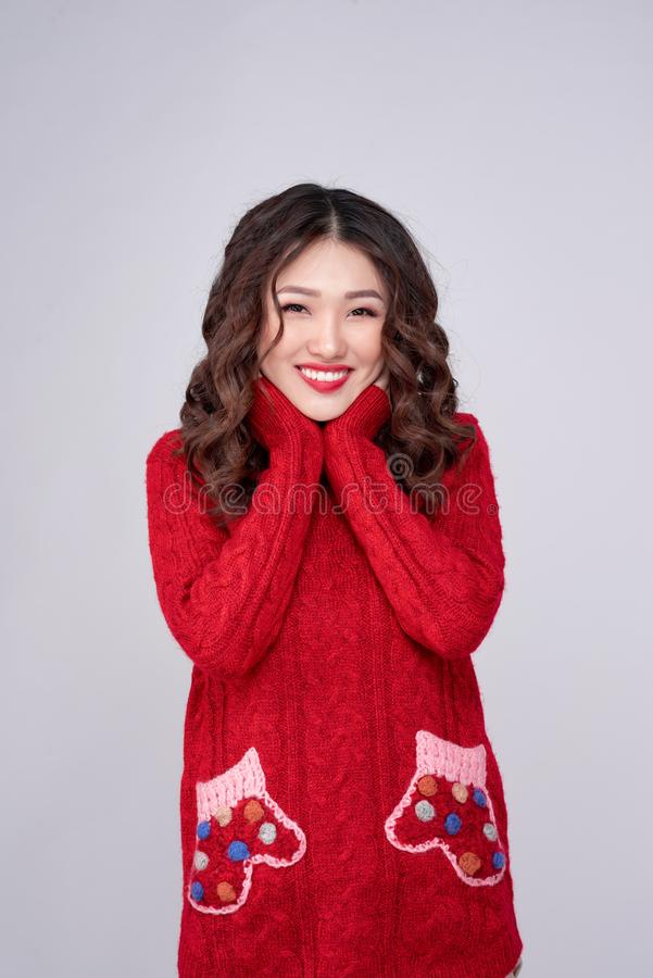 Portrait of beauty winter asian girl in red knitted woolen dress. Christmas Holiday royalty free stock image