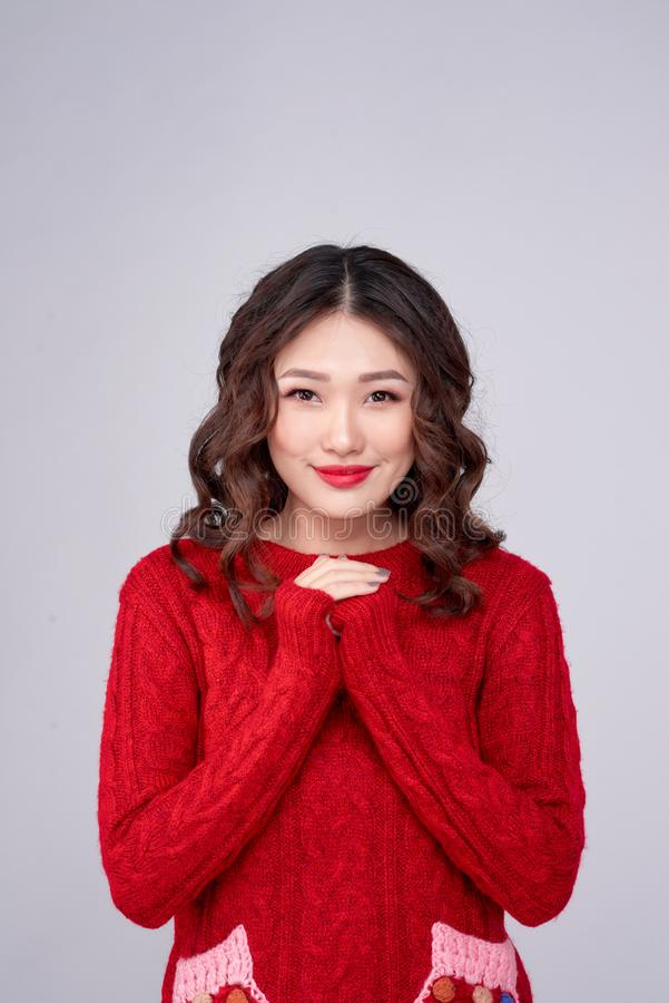 Portrait of beauty winter asian girl in red knitted woolen dress. Christmas Holiday royalty free stock photography