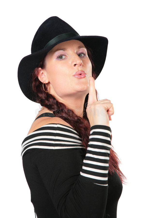 Portrait of beauty woman in black hat. Makes gesture smoking gun by finger royalty free stock photo