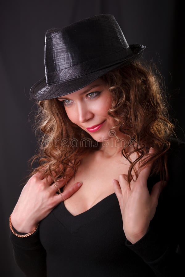 Portrait Of Beauty Woman In Dark Hat Stock Photography