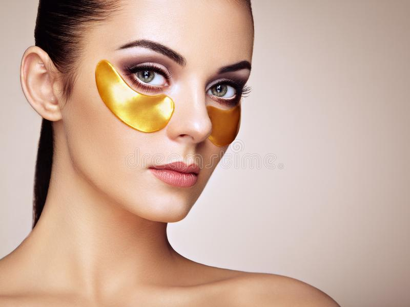 Portrait of Beauty woman with eye patches stock photography
