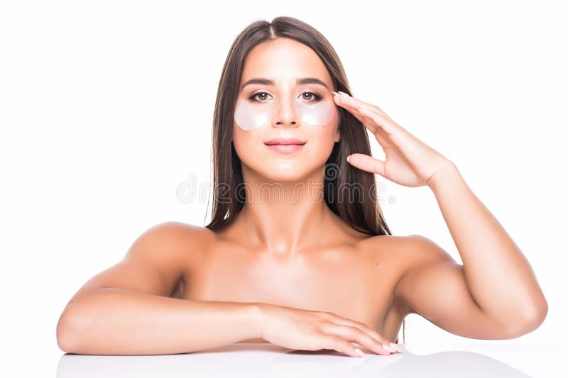 Portrait of beauty woman with eye patches. Woman beauty face with mask under eyes. Beautiful female with natural makeup and white stock photo