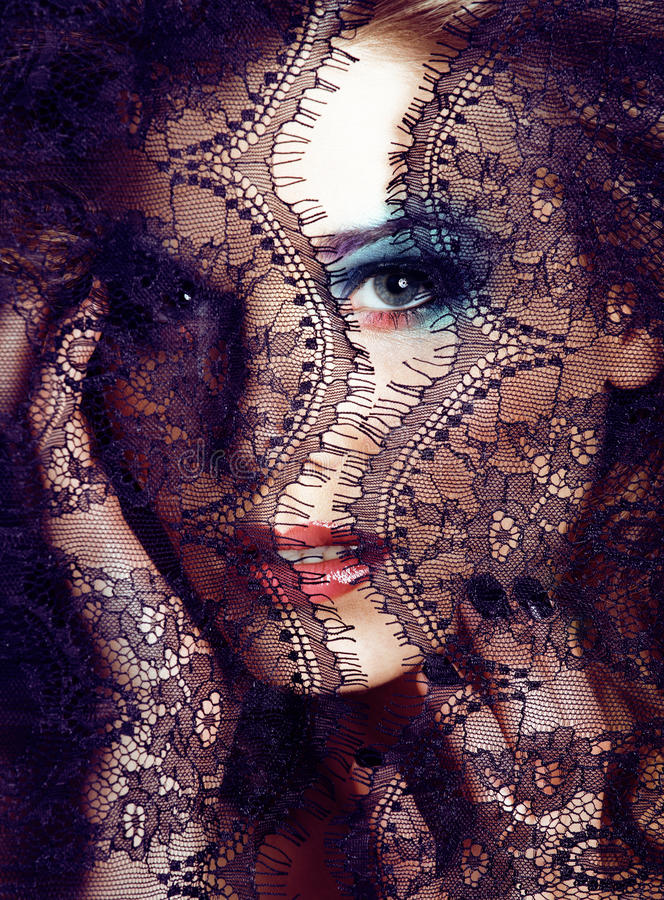 Portrait of beauty young woman through lace close up mistery makeup sexy, fashion people concept stock photos