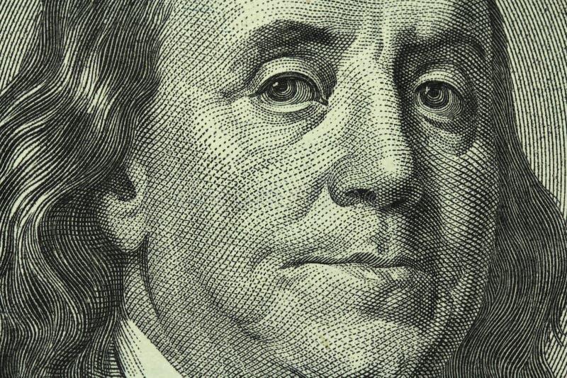Portrait of Benjamin Franklin on the hundred dollar bill stock photo