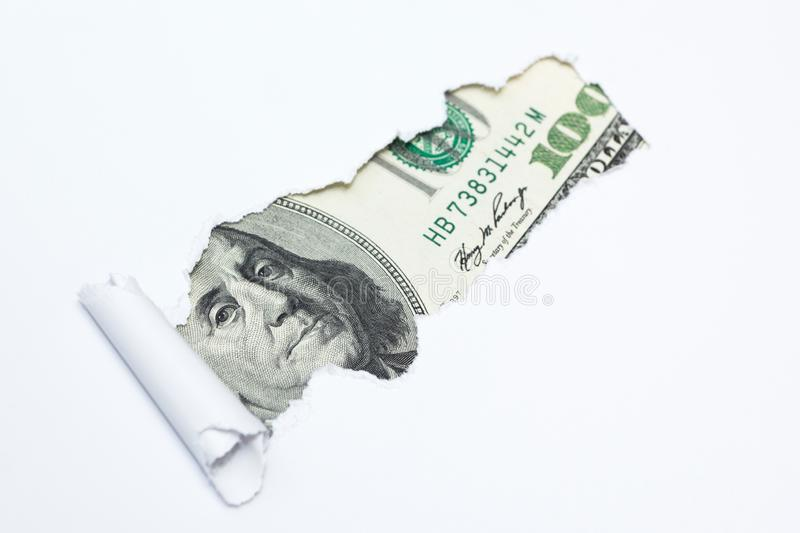 Portrait of Benjamin Franklin on a hundred dollar bill in the gap hole of a white background. Dirty money, tax evasion royalty free stock images