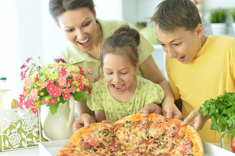 Portrait of big happy family eating pizza together stock images