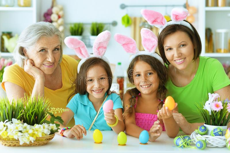 Portrait of big happy family painting traditional Easter eggs stock photo