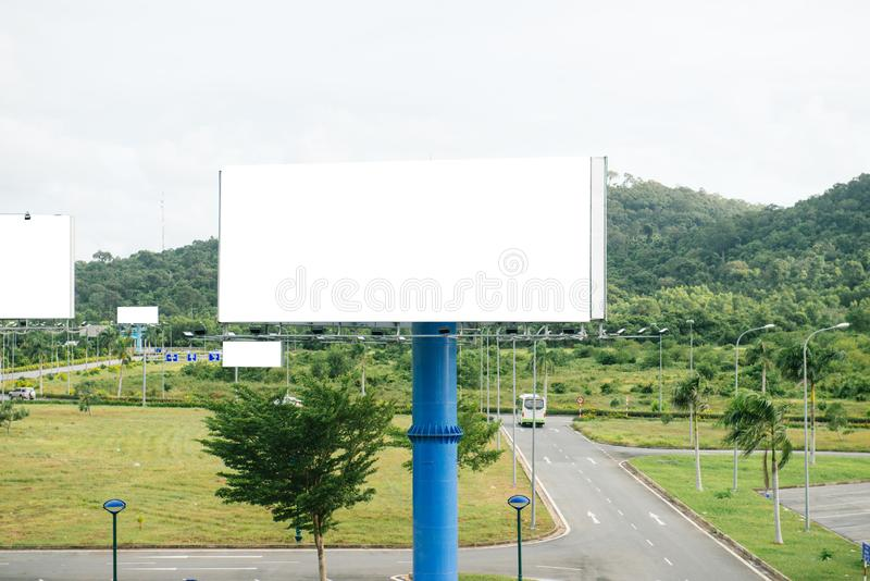 Portrait billboard blank for outdoor advertising poster at sunset blue sky.  royalty free stock photos