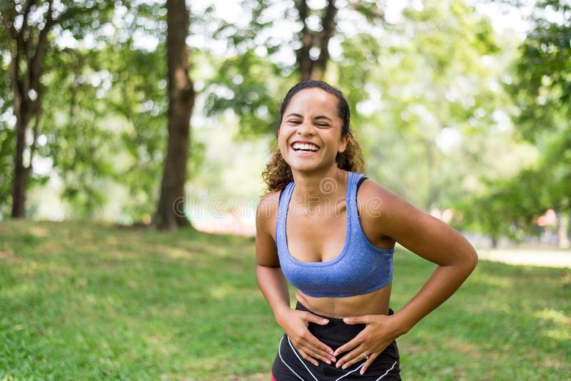 Portrait of black beautiful woman laughing and funny after break workout at park,Happy and smiling,Relaxing time stock images