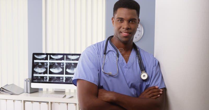 Portrait of black medical doctor in hospital. Portrait of black male medical doctor in hospital royalty free stock images