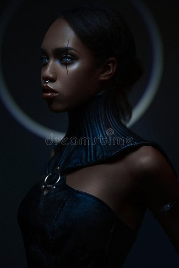 Portrait of black woman with gothic collar. Posing on dark background stock image