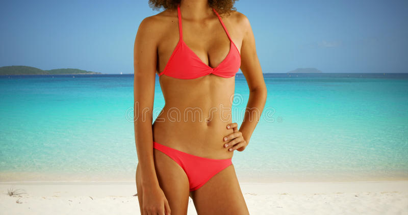 Portrait of black woman wearing bikini on a sunny Caribbean beach. royalty free stock image