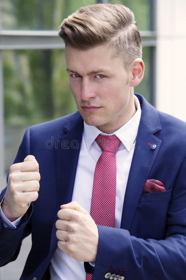 Portrait of blond businessman posing as a boxer stock image