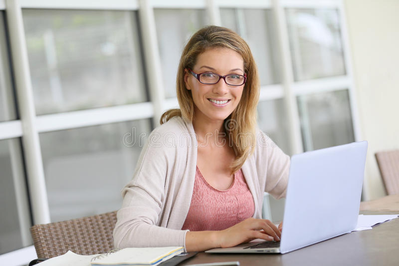 Portrait of a blond businesswoman teleworking stock photography