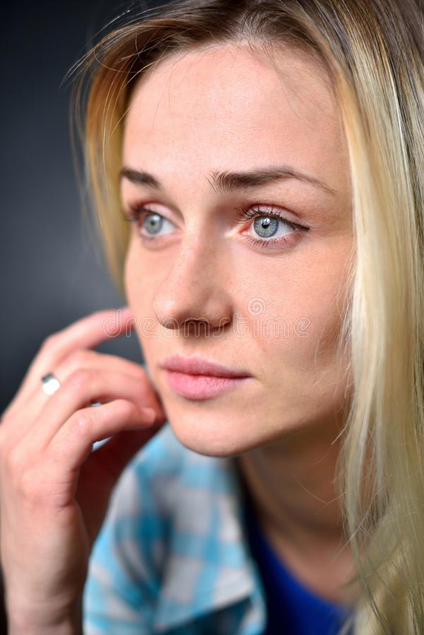 Portrait of a blond girl, close-up royalty free stock images
