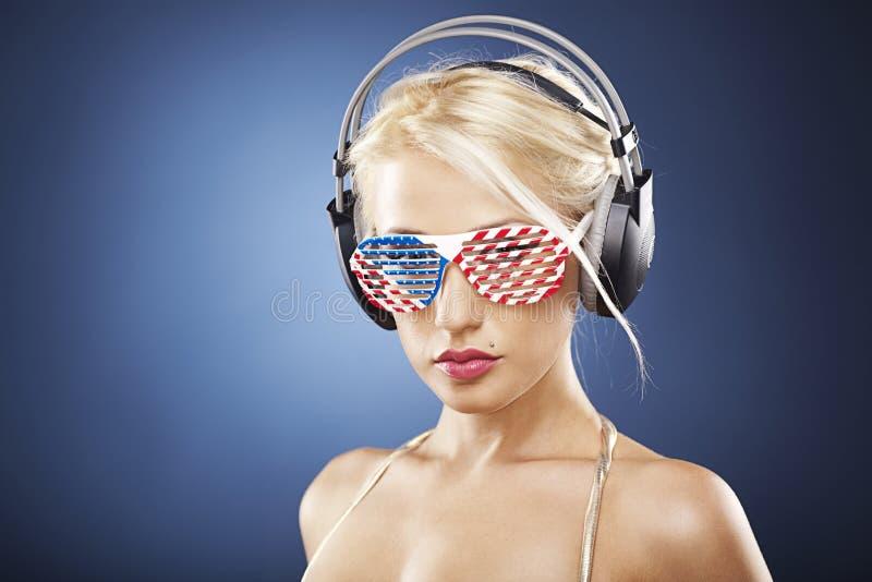Portrait Of Blond Girl In Gold Swimwear Stock Image