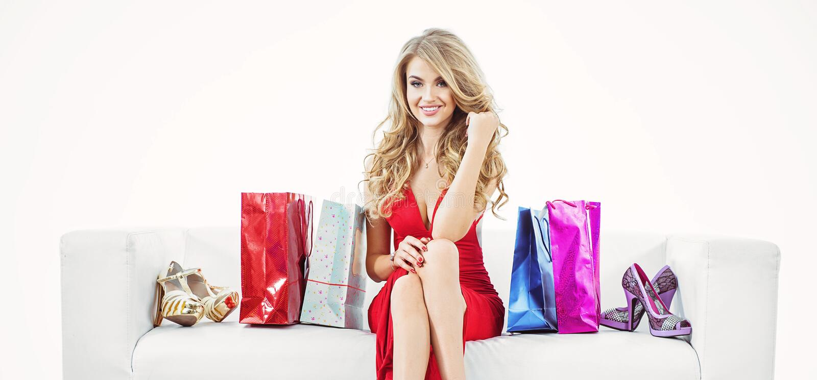 Portrait of a blond woman with a bunch of shopping bags royalty free stock photo