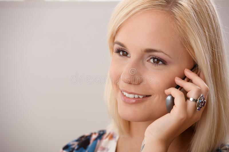 Portrait of blond woman on phone call royalty free stock photo