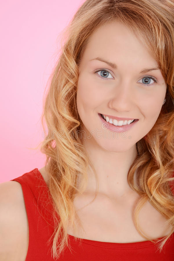 Portrait blond woman on pink royalty free stock photo