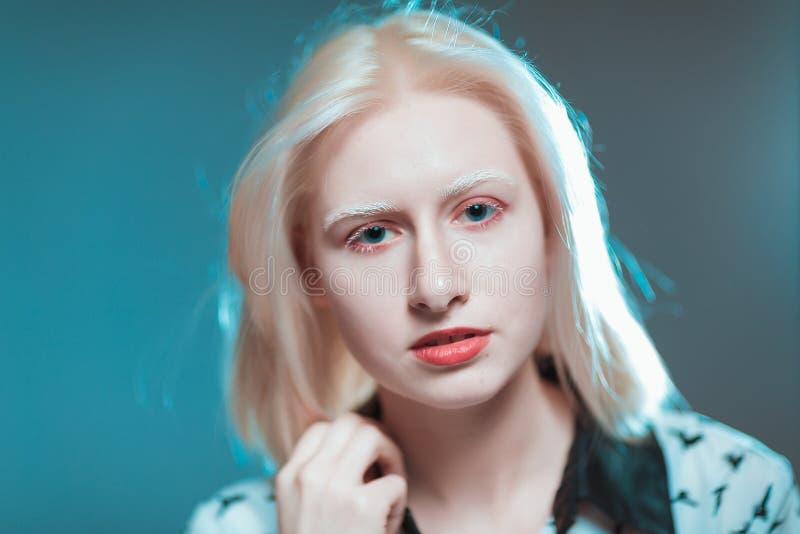 Portrait of blonde albino girl in studio royalty free stock images