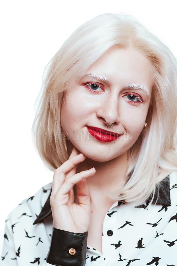 Portrait blonde albino girl in studio on white background stock image